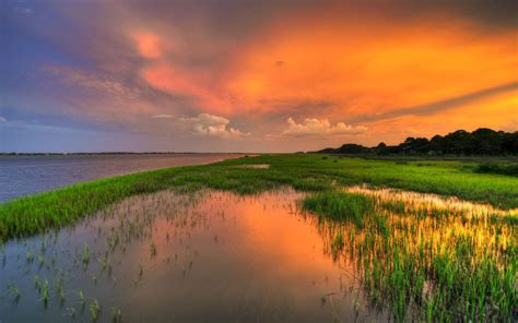 Sunset Red Sky River Field With Green Grass Hd Wallpaper